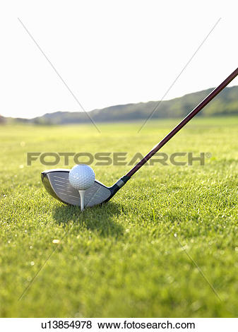 Pictures of Driver and goof ball on tee u13854978.