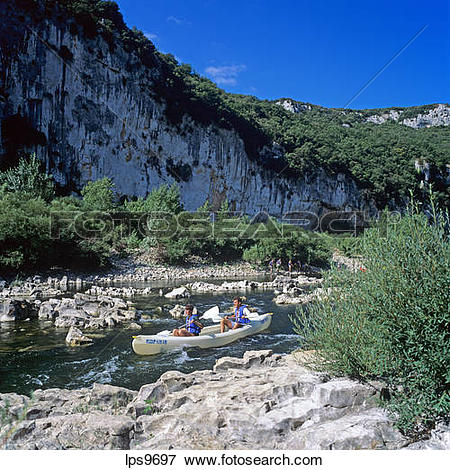 Picture of YOUNG COUPLE CANOEING ON RIVER GORGES DE L'ARDECHE.