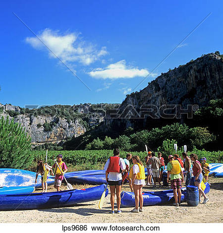 Stock Images of PEOPLE WITH CANOES ON ARDECHE RIVER BANK GORGES DE.