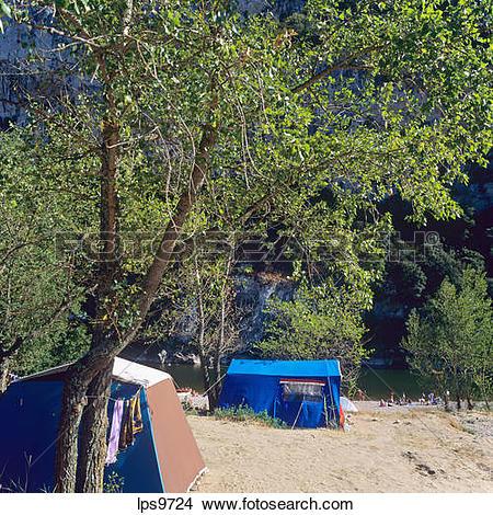 Stock Photo of CAMPSITE ON ARDECHE RIVER BANK GORGES DE L'ARDECHE.