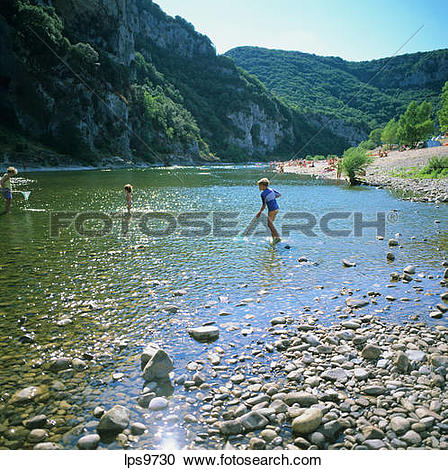 Stock Photography of WOMAN AND TWO CHILDREN FISHING IN ARDECHE.