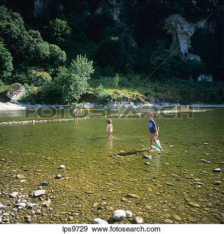 Stock Photograph of WOMAN AND TWO CHILDREN FISHING IN ARDECHE.