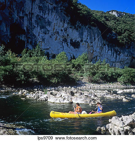 Stock Photograph of COUPLE CANOEING ON RIVER GORGES DE L'ARDECHE.