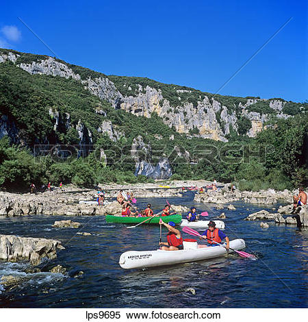Stock Image of PEOPLE CANOEING ON RIVER GORGES DE L'ARDECHE.