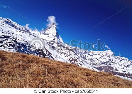 Stock Photography of Landscape of Matterhorn peak with dry meadow.