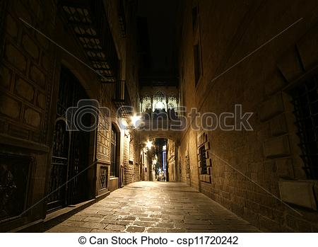 Stock Photo of Gothic quarter at night. Empty alleyways in.