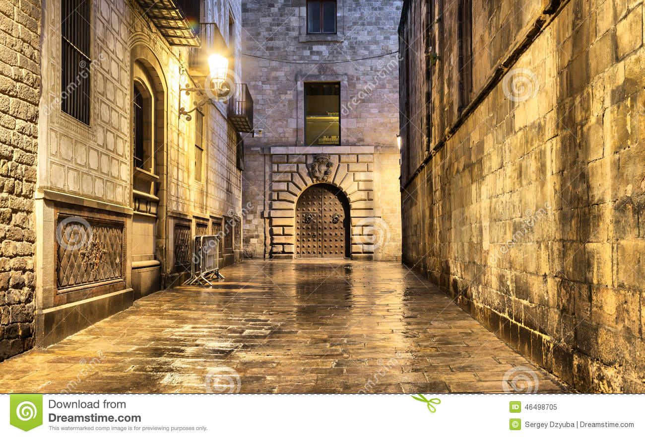 Wet Narrow Street In Gothic Quarter, Barcelona Stock Photo.