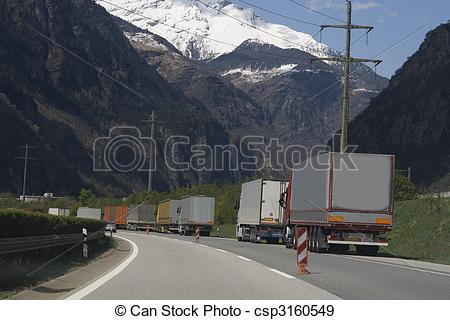 Stock Photographs of Trucks waiting for entrance Gotthard tunnel.