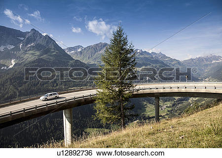 Stock Images of Car on elevated highway to Gotthard Pass.