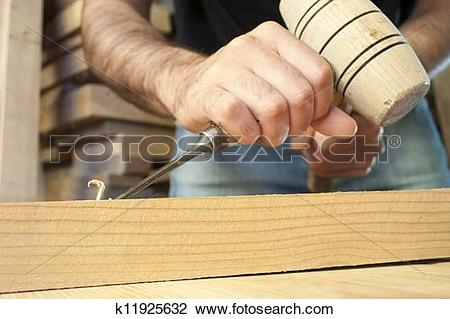 Stock Photo of gouge wood chisel carpenter tool working wooden.
