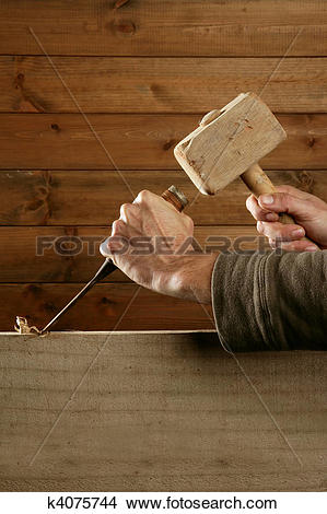 Stock Photo of gouge wood chisel carpenter tool hammer hand.