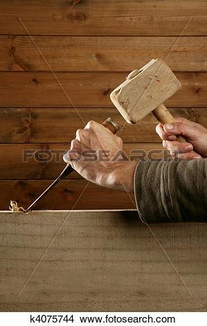 Stock Photo of gouge wood chisel carpenter tool hammer hand.
