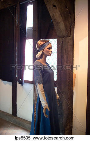 Stock Image of dummy with ancient dress inside maison du.