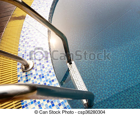 Stock Photography of Grab bars ladder in blue swimming pool.