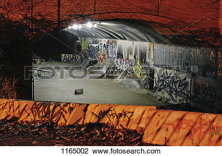Stock Photo of Skateboarding ramps and graffiti in a tunnel at.