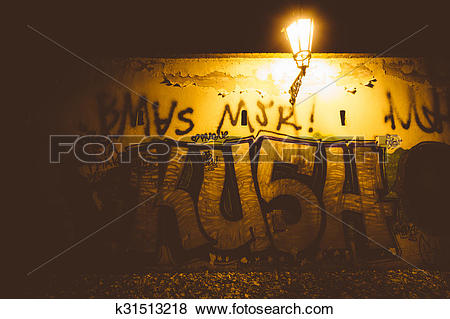 Pictures of Graffiti on a wall at night, in Prague, Czech Republic.