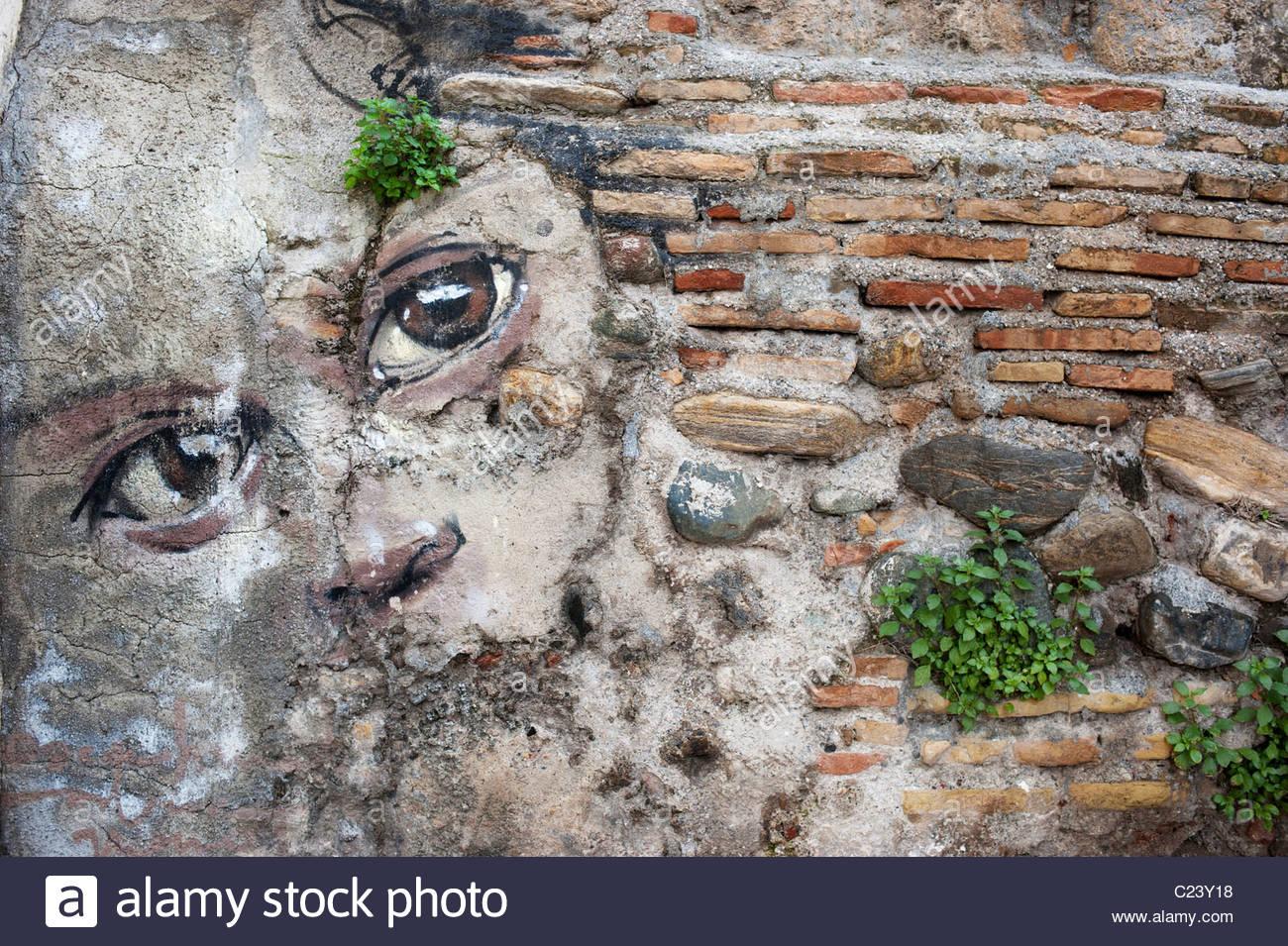 Graffiti Wall Art Painting Of A Face In The Moorish Albayzin.