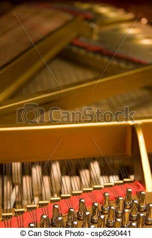Stock Photography of Grand Piano hammers and strings.