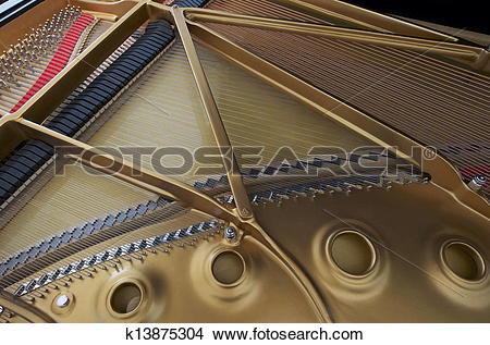Stock Photo of Harp and Soundboard of Grand Piano k13875304.