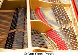 Stock Photo of Closeup of grand piano showing the strings, pegs.