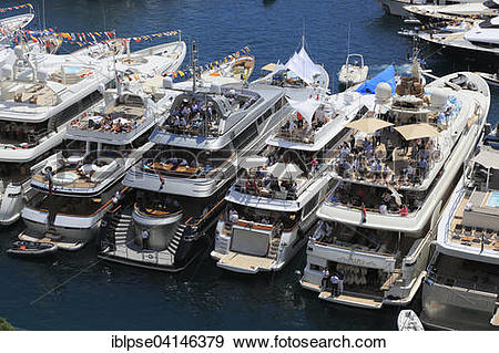 Stock Photograph of Viewers on yachts in Port Hercule, Formula 1.
