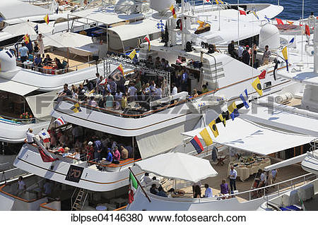 Stock Photography of Viewers on yachts in Port Hercule during the.