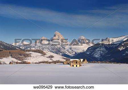 Stock Photograph of Old abandoned farm buildings in winter evening.