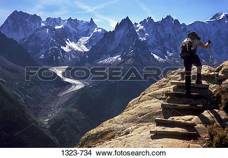 Stock Photo of Rear view of a person hiking on a mountain, Dent du.