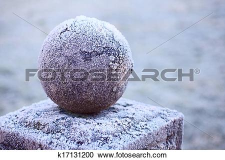 Stock Photography of granite ball on a pedestal k17131200.