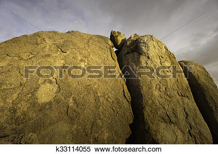 Stock Image of Dramatic desert rock formation k33114055.