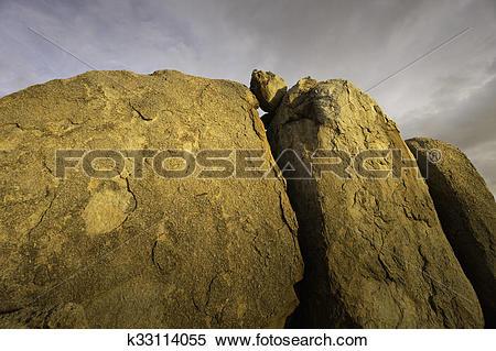 Stock Image of Dramatic desert rock formation k33114055.