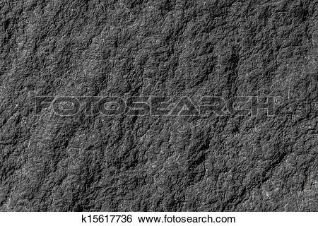 Stock Images of natural stone granite wall with rough structure.