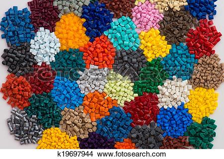 Stock Photo of dyed plastic granulate resins k19697944.