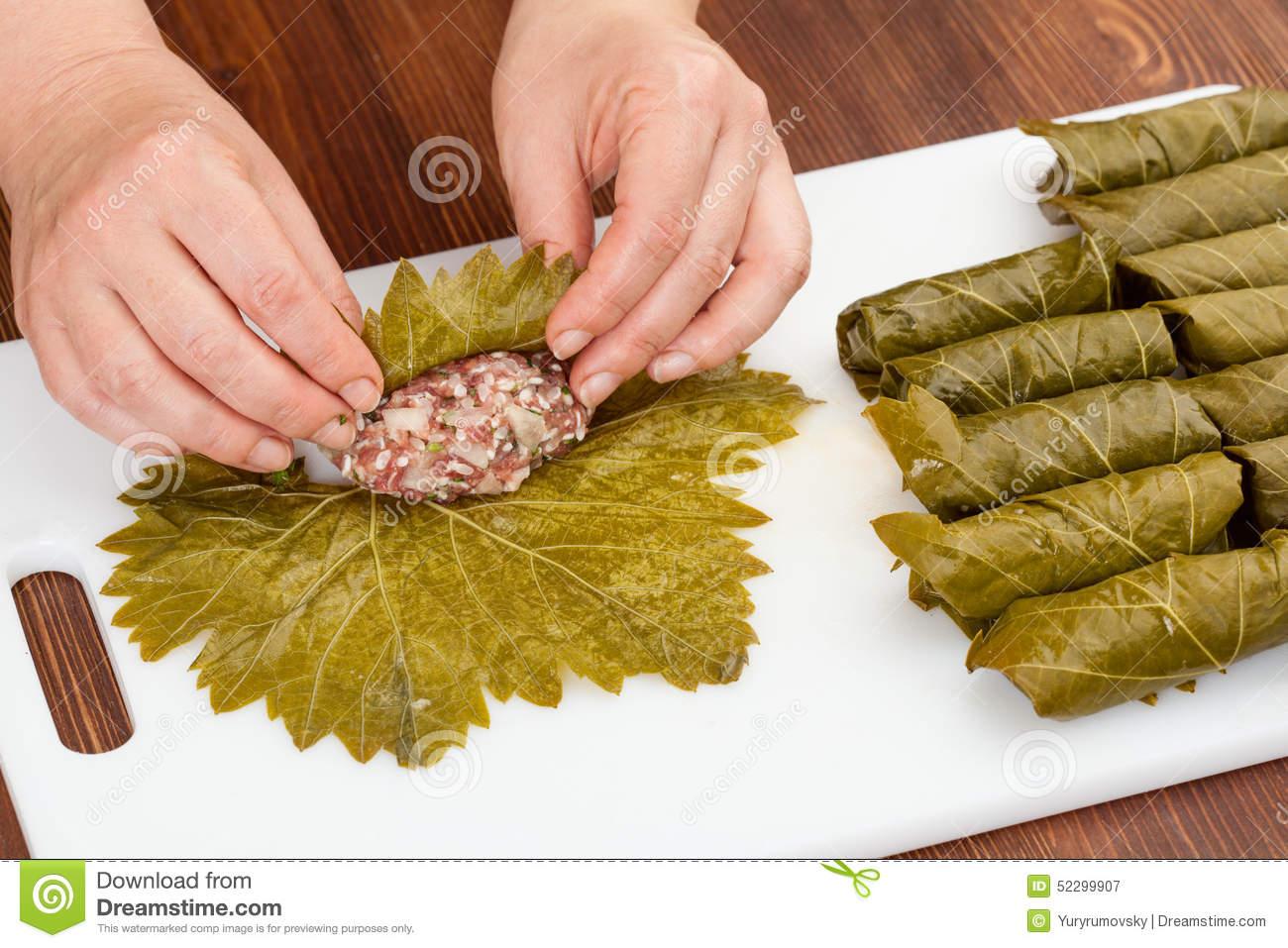 Cabbage Rolls With Grape Leaves Stock Photo.