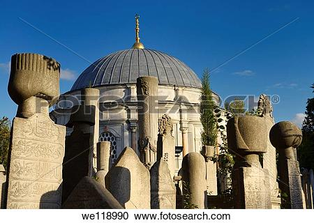 Stock Photography of Sun on grave stones and Mausoleum in the.