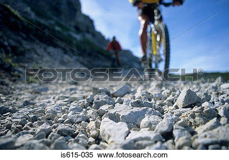 Stock Image of Cycling on rocky path. is615.