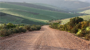 Gravel Dirt Road Going Downhill Stock Photos, Images, & Pictures.