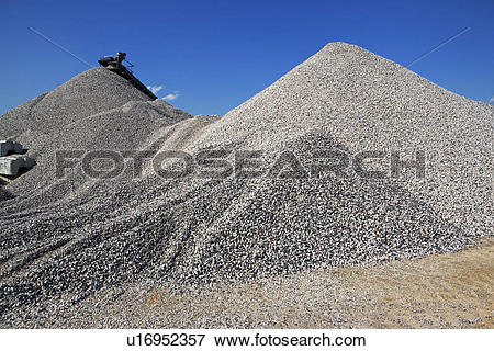 Picture of Gravel mounds at concrete plant u16952357.