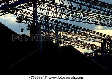 Picture of Silhouette of worker at gravel quarry plant x75363347.