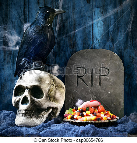 Pictures of crow, skull, gravestone and Halloween candies.