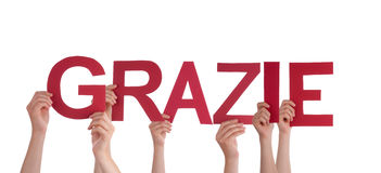 Child Holding Sign With Italian Word Grazie.