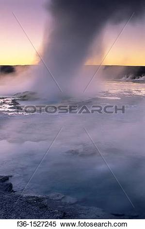 Stock Image of Steam boils out of Fountain Geyser at sunset.