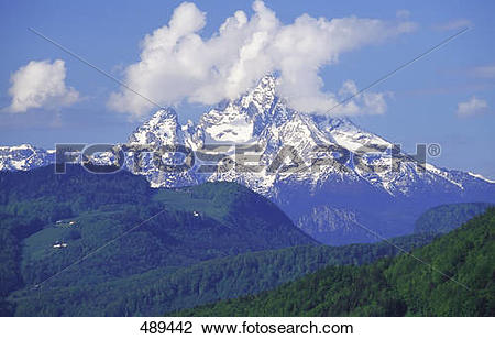 Stock Photo of Clouds over snowcapped mountain, Mt Watzmann.