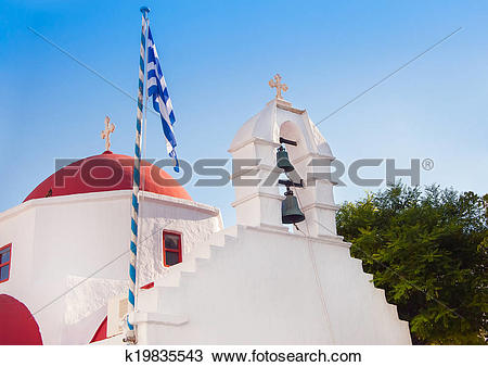 Stock Photo of A white church with red roof at Greek town of.