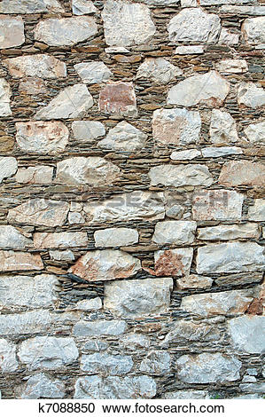 Stock Photography of Traditional greek wall by rocks k7088850.