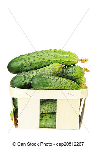 Stock Image of pile of cucumber in a veneer basket isolated over.