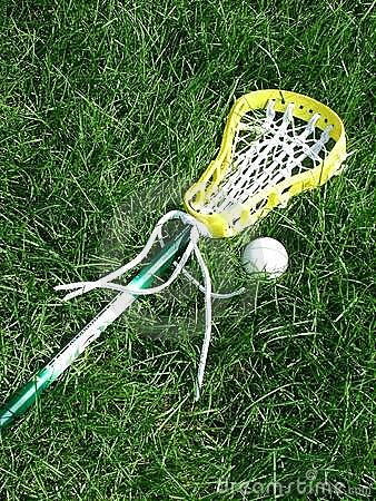 Lacrosse Stick And Ball Stock Photo.