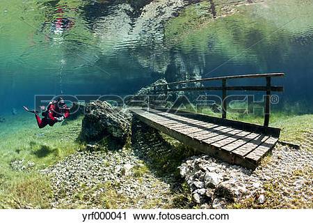Stock Photography of Austria, Styra, Tragoess, Green Lake, Diver.