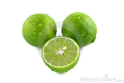 Green Lemon With Water Droplets Stock Photo.