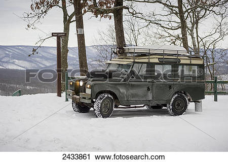 Stock Photography of Land Rover parked near Point Lookout sign in.